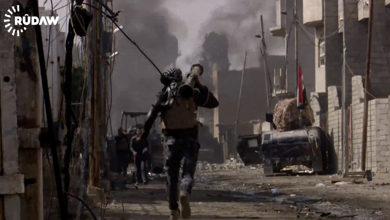 An Iraqi soldier rushes to aid his fellow comrades after an ISIS car bomb exploded nearby in the newly liberated Jawsaq neighborhood in western Mosul. Photo: Rudaw video
