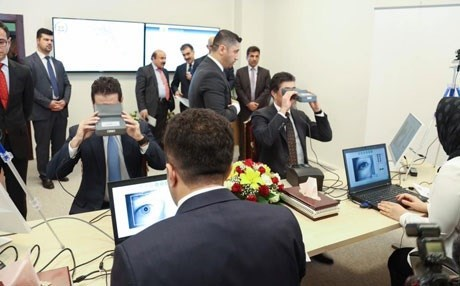 Prime Minister Nechirvan Barzani (R) and Deputy Prime Minister Qubad Talabani (L) were among the first government employees to be registered in the new system. Photo: Rudaw