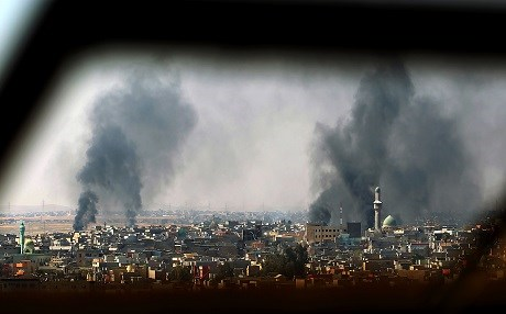 Smoke rises into the sky of Mosul on Friday as the Iraqi forces are increasingly taking ground against the ISIS militants in western Mosul. Photo: AFP/Ahmad al-Rubaye