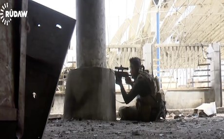 An Iraqi army soldier with his rifle pointed at ISIS movements in Bab at Tob neighborhood in Mosul. Photo: Rudaw video