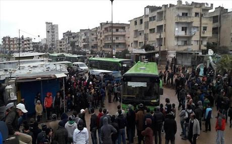 Evacuation process of rebel fighters and civilians from Waer district, western Homs, Syria on March 18, 2017. Photo: AA