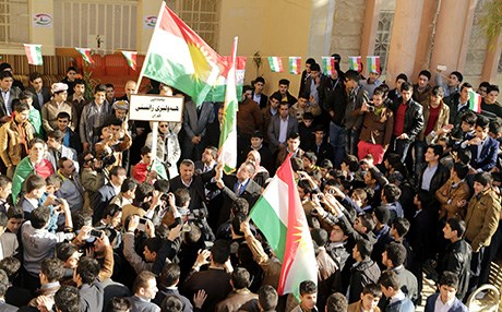 People wave the flag of the Kurdistan Region. Photo: Rudaw