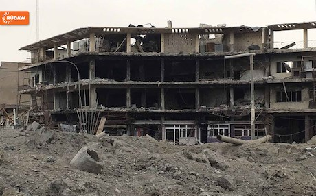 Buildings in the embattled west Mosul bear visible scars of war and destruction.