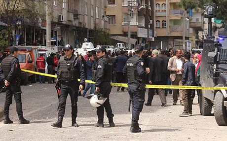 Turkish security investigate the scene of an explosion Diyarbakir on Tuesday. Photo: AA