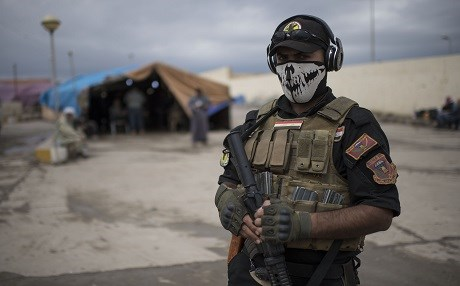 A member of the Iraqi counter-terrorism service forces at a processing center for displaced citizens in western Mosul. Photo: AFP/Christophe Simon