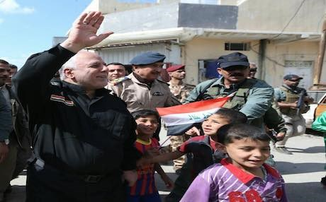 Prime Minister of Iraq Haider al-Abadi greeting civilians as he visited west Mosul. Photo: Courtesy of PM