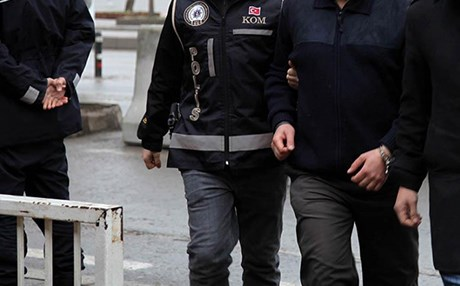 Turkish security officials escort a handcuffed man. Photo: AA