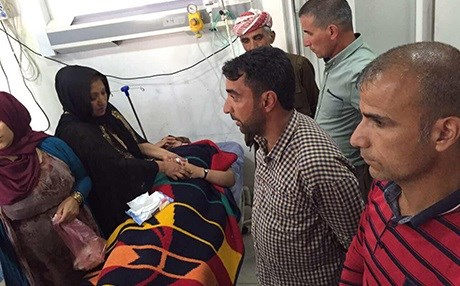 Relatives visit Nergiz Hussein, injured in a Turkish aerial attack, in a hospital in Duhok. Photo: Rudaw