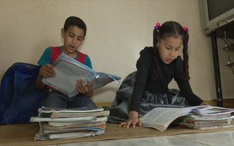 Mustafa Abdullah [L], a 5th-grader student displaced to the Kurdish city of Halabja study with his sister in a rented home. Their father, a teacher with Master's degree is on strike over unpaid salaries. Photo: Rudaw video