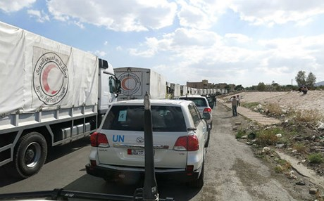 A convoy of UN and Red Crescent humanitarian aid stands still in Syria. Photo: UN WFP