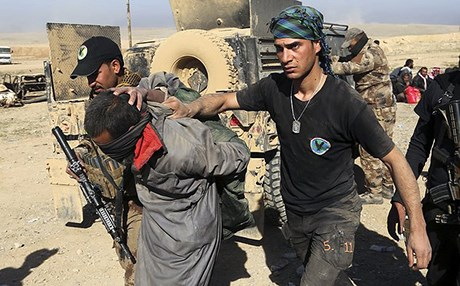 Iraqi security forces detain a suspected ISIS fighter in Mosul on February 25, 2017. Photo: AP