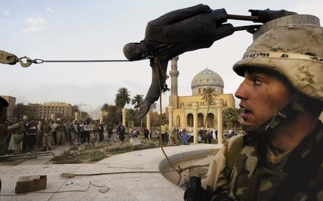 American soldiers and Iraqi civilians pulling down Saddam Hussein's statue in central Baghdad, April 9, 2003. Photo: AP
