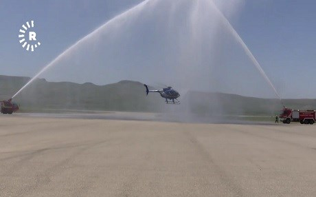 A helicopter flies through a shower of water in a ceremony on Wednesday. Photo: Rudaw TV
