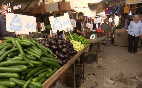 Food items for sale in the Nabi Younis market in eastern Mosul on Thursday. It reads cucumber and aubergine for 500 Iraqi dinars, about 40 cents. Photo: Rudaw video