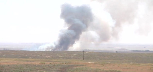 Plumes of smoke rising in the skyline of the Yezidi village of Tal banat, southeast of Shingal on Saturday as the mainly-Shiite Hashd al-Shaabi forces continued to push forward against the ISIS militants. Photo: Rudaw video.