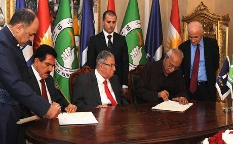 PUK and Gorran officials while signing a historic agreement in Sulaimani, with PUK leader Jalal Talabani seated in between on 17 May 2016. File photo: Rudaw