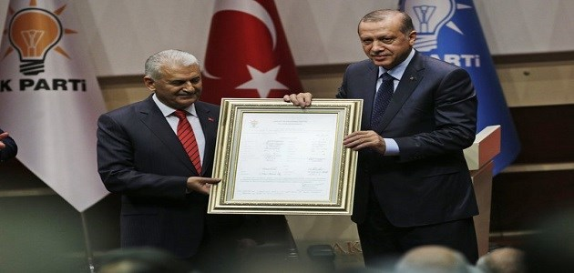 Turkey's President Recep Tayyip Erdogan, right, poses for photograph with Turkey's Prime Minister Binali Yildirim, left, during a ceremony to rejoin the ruling Justice and Development Party, or AKP, in Ankaraon on May 2, 2017. . He was the head of the party for 13 years from 2001 until 2014 when he was forced to cut his ties with the party in accordance to the previous constitution. Photo: AP /Burhan Ozbilici.