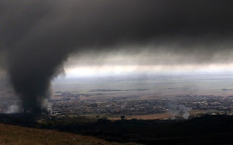 Heavy smoke covers the town of Sinjar during an operation by Iraqi Kurdish forces on November 12, 2015. Photo: Safin Hamed | AFP