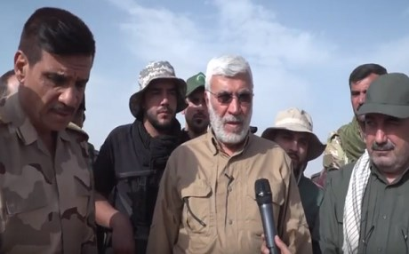 Mahdi Muhandis [M], the deputy head of the mainly Shiite Hashd al-Shaabi speaks to a reporter in the liberated village of Kocho, a Yezidi area that has become the face of the ISIS genocide against the Yezidis . Photo: Hashd media office
