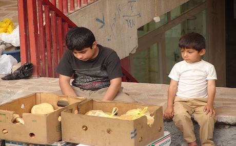 Children sit on a stoop in the Kurdish city of Sulaimani. Photo: Rudaw