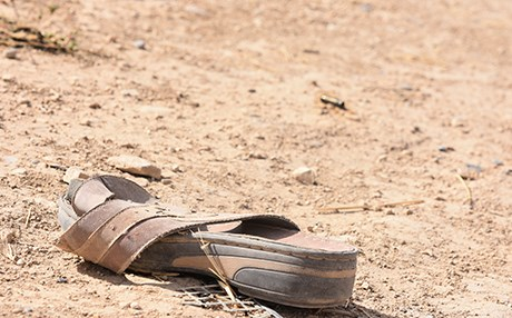 A shoe lies in the war-ravaged village of Kocho in the Shingal region. Photo: Chris Johannes | Rudaw