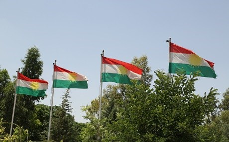 The flag of the Kurdistan Region flaps in the wind. Photo: Rudaw