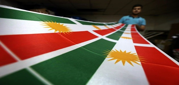 A man prints a flag of Kurdistan in Erbil on June 8, 2017. The Kurdish government will hold a historic referendum on statehood on September 25, despite opposition to independence from the central government of Iraq. Photo: AFP/Safin Hamed