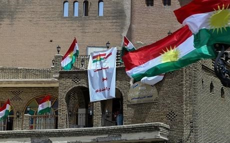 Kurdish flags and posters saying