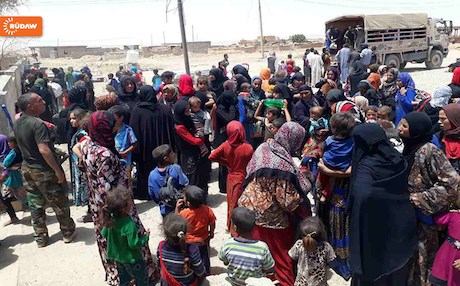 Internally displaced persons (IDPs) from Tal Afar reach Peshmerga forces after fleeing home.