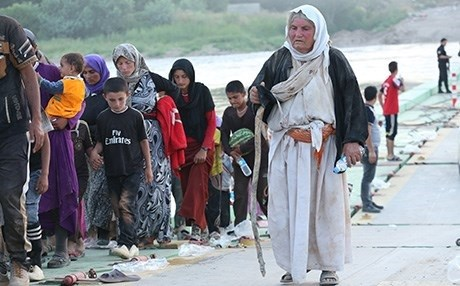 A number of Yezidi women and children flee ISIS near the border of Syria. File photo: Rudaw