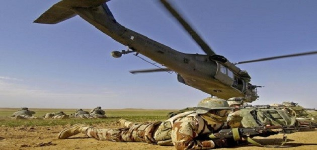 AFP file photo: Iraqi and US soldiers securing a landing zone after departing from a UH-60 Black Hawk helicopter during an assault mission in Iraq near the Syrian border.