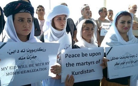 Yezidi women hold up signs during a demonstration outside of the United Nations compound in Erbil. Rudaw file photo