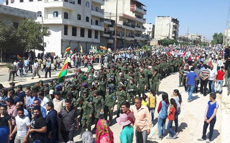 The demonstration is reportedly organized by the ruling Democratic Union Party (PYD) in Rojava or northern Syria. Photos by ANF