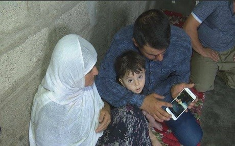 Family of a 23-year old Kurdish man show photos of his imprisonment. They say he was kidnapped by the mainly-Shiite Hashd al-Shaabi forces in Tuz Khurmatu and then referred to the town's police under the accusation of being a terrorist. Photo: Rudaw video