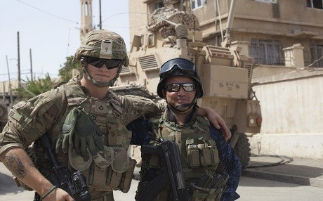 A US Army private first class of the 82nd Airborne embraces a member of the Iraqi Federal Police in July in Mosul. Photo: Cpl. Rachel Diehm | US Army