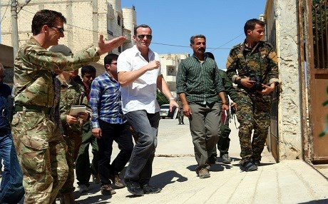 US Envoy to the Global Coalition Brett McGurk [C], and Rupert Jones [L], depurt commander of the coalition's Combined Task Force, arrive for a meeting with officials in the Syrian town of Tabqa in Syria on JUne 29, 2017. Photo: AFP, Delil Souleiman.