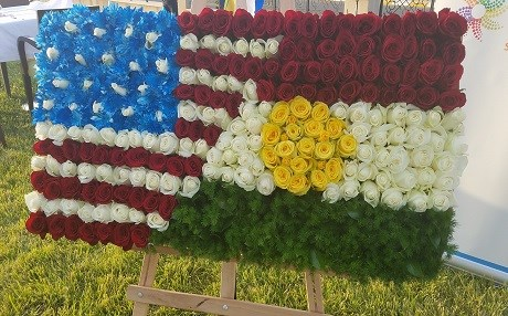 The American and Kurdish flags woven together with roses at an American independence day event in the Kurdistan Region on July 4, 2017. Photo: Rudaw
