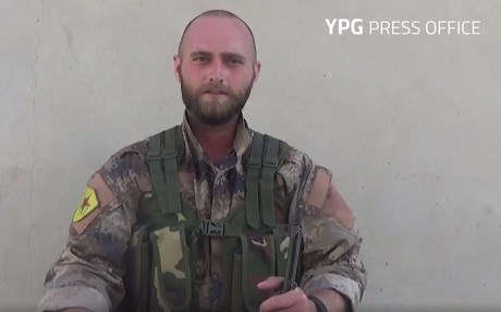 David Taylor, nom de guerre Zafer Qerecox, is shown in military fatigues bearing a YPG patch. Photo: YPG Press