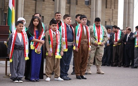 Kurdish children sporting traditional costumes on Kurdistan Flag Day in front of the parliament building in Erbil. Photo by Farzin Hassan/Rudaw