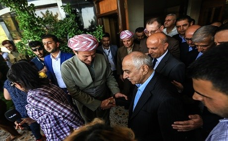 Gorran's newly elected leader Omar Ali [R] and Adham Barzani, from the Kurdistan Democratic Party, shake hands as a KDP delegation visited Gorran's headquarters in Sulaimani to congratulate Ali's election as party's leader in July 2017. File photo:Rudaw/Sartip Othman