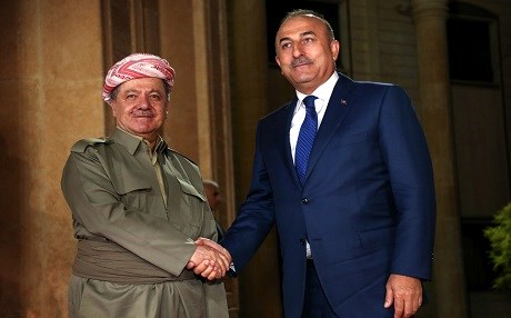 Kurdish president Masoud Barzani (left) shakes hands with Turkish Foreign Minister Mevlut Cavusoglu on August 23, 2017 in Erbil. Photo AFP/ Safin Hamed