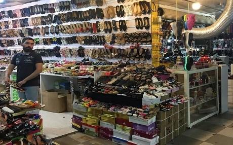 caterpillar shoes erbil tpt store name