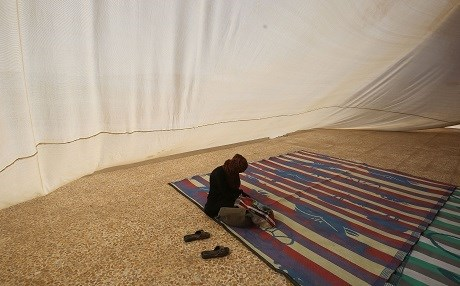 A displaced Iraqi woman from Nineveh province sits in a tent in a camp. Photo: Ahmad Al-Rubaye | AFP