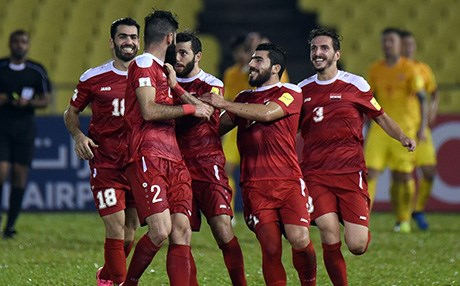 Syria players celebrate a goal during the 2018 FIFA World Cup Asian Qualifier against China. Photo: Stanley Chou/Getty Images