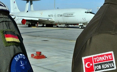 A German crew member (L) stands next to a Turkish NATO MP (right) at Konya airbase in 2003. Photo: AP