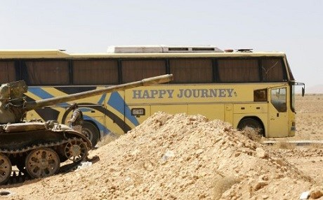 A bus waiting to transport ISIS fighters from the Syria-Lebanon border on August 28. Photo: AFP