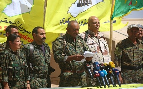 Ahmad Abu Khawlah (3rd-R), chief of the Deir ez-Zor Military Council -- a coalition of Arab tribes and fighters that belongs to the broader US-backed Syrian Democratic Forces -- speaks during a press conference in the northeastern Syrian village of Abu Fas, on the southern outskirts of Hasakah province, on September 9, 2017. Photo: AFP / Delil Souleiman