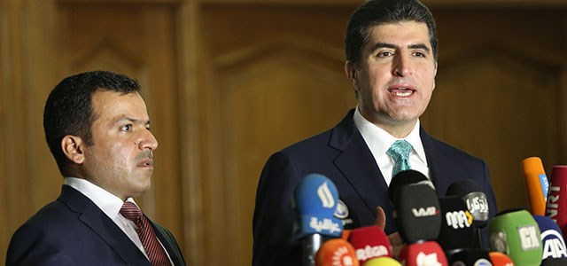 File photo: Parliament speaker Yousif Mohammed, a Gorran member [L], and Prime Minister Nechirvan Barzani, a KDP member, attend a press conference in 2014. The Kurdish parliament has not convened since October 2015 because of tensions between the two parties. Photo: Rudaw