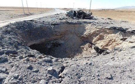 An airstrike gouged a giant hole in the road that served as a vital supply route for ISIS before Kurdish fighters recaptured Shingal. Photo: Kurt Nagl/Rudaw
