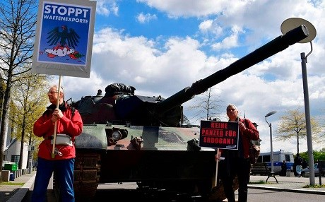 Activists protest plans of German military technology group Rheinmetall to build a tank factory in Turkey. Protesters in April hold a sign saying 'No armor for Erdogan.' Photo: John MacDougall/AFP